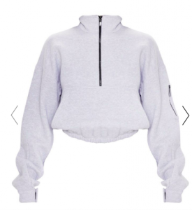 IImage via Pretty Little Thing [image description: oversized grey pullover quarter zip sweater from Pretty Little Thing on a white background]