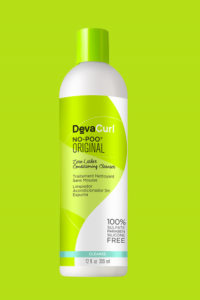 [Image description: DevaCurl No-Poo Cleansing Conditioner with a green background.]