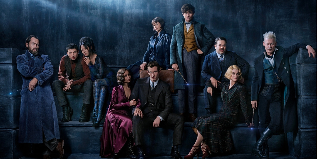 Photo of the cast of Fantastic Beasts: The Crimes of Grindelwald standing or sitting in various poses