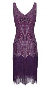 A purple beaded sleeveless flapper-style dress with fringe along the bottom