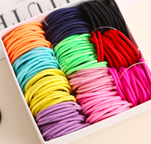 A box of colorful hair ties