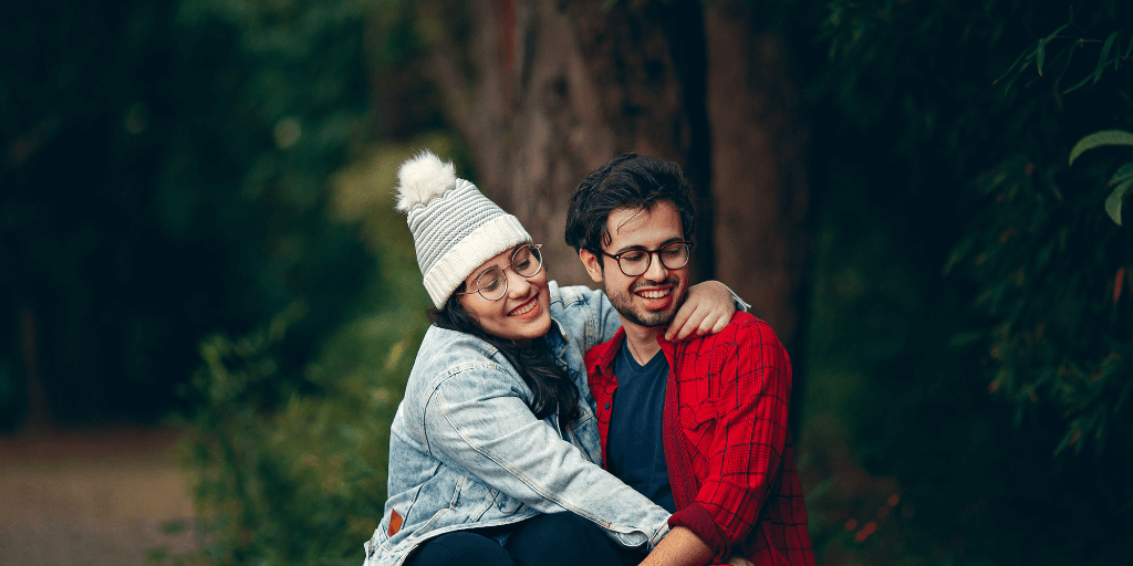 [Image description: Partner holds on to his partner in the forest] Photo by Helena Lopes from Pexels