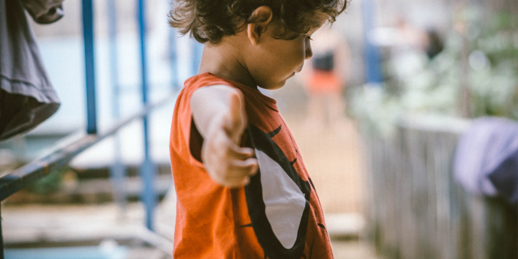 A child wearing a Spider-man shirt.