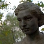 [Image description: A close-up of a bronze bust of Noor Inayat Khan in a park] Via Wikimedia Commons