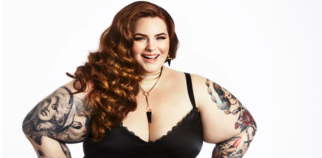 Modern day fat acceptance activist Tess Holiday smiling.