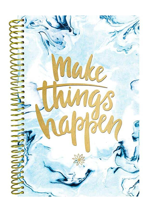 """A blue patterned, hardcover planner with the words """"Make things happen"""" in cursive on top."""