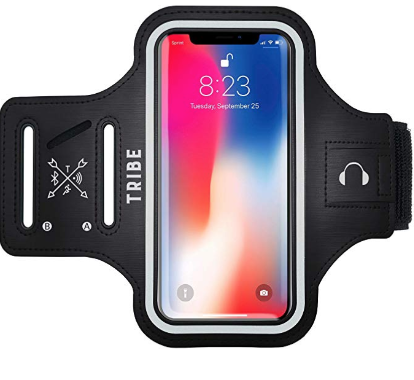 """[Image Description: Armband phone case with aSamsung Galaxy phone displayed within it. The armband has the words """"TRIBE"""" written on the left side.] Photo via Amazon"""