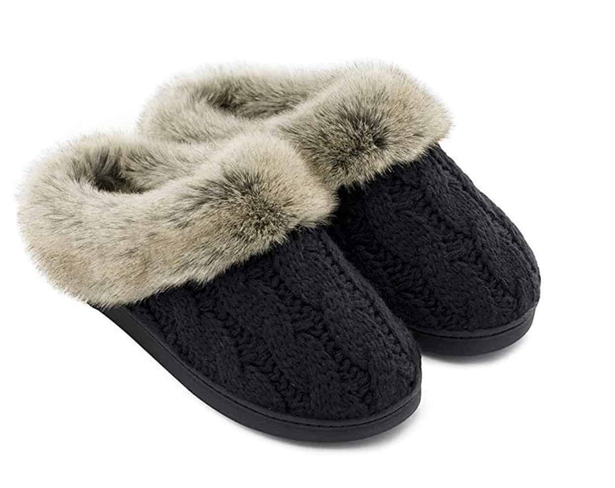 A pair of black, cable-knit slippers.