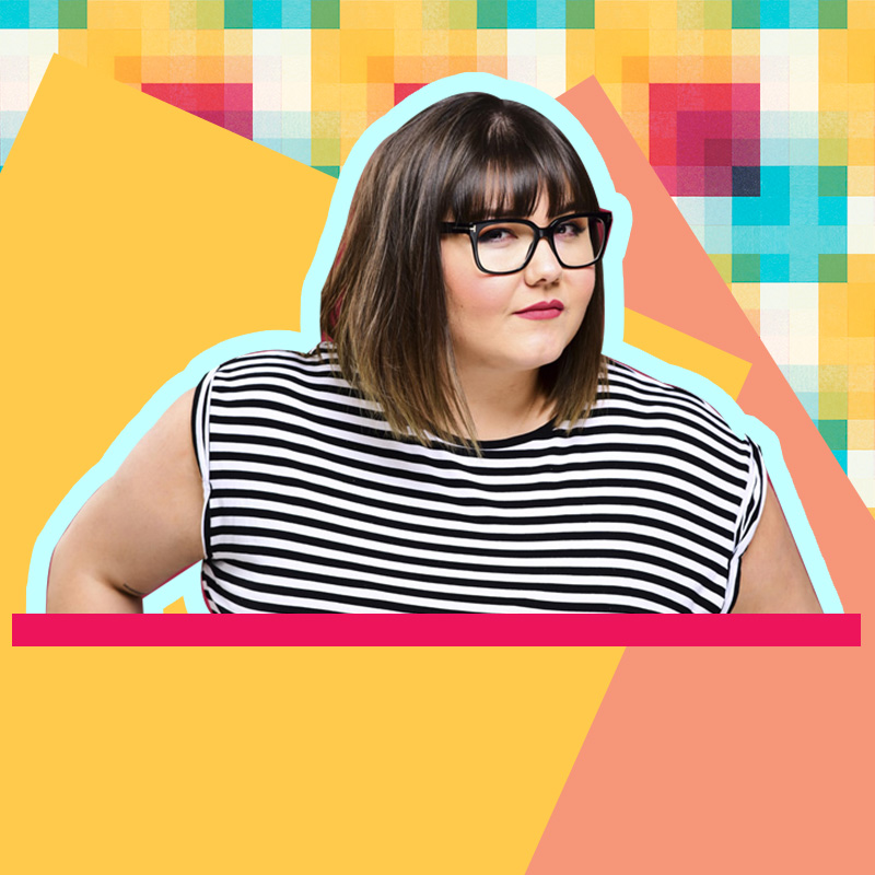 Sofie Hagen in a striped top and glasses looks at the camera. [via British Comedy Guide]