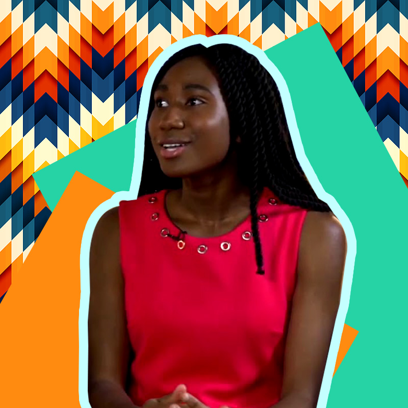 Miracle Olatunji looks away from the camera while smiling. She is wearing a red sleeveless top, and her hair is let down.