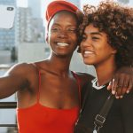 Two black women taking a selfie on Galentine's Day.