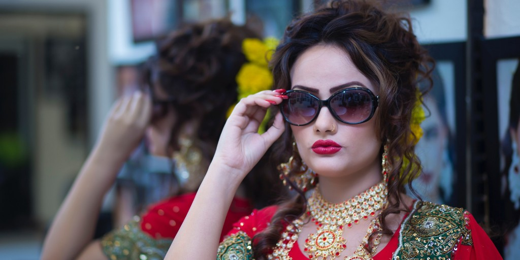 [Image Description: Woman wears sunglasses in bridal wear.] via Pexels