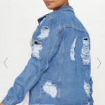 Picture of a model wearing a ripped light wash denim jacket