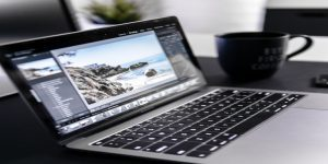 a laptop shows  a picture of a beach open for editing