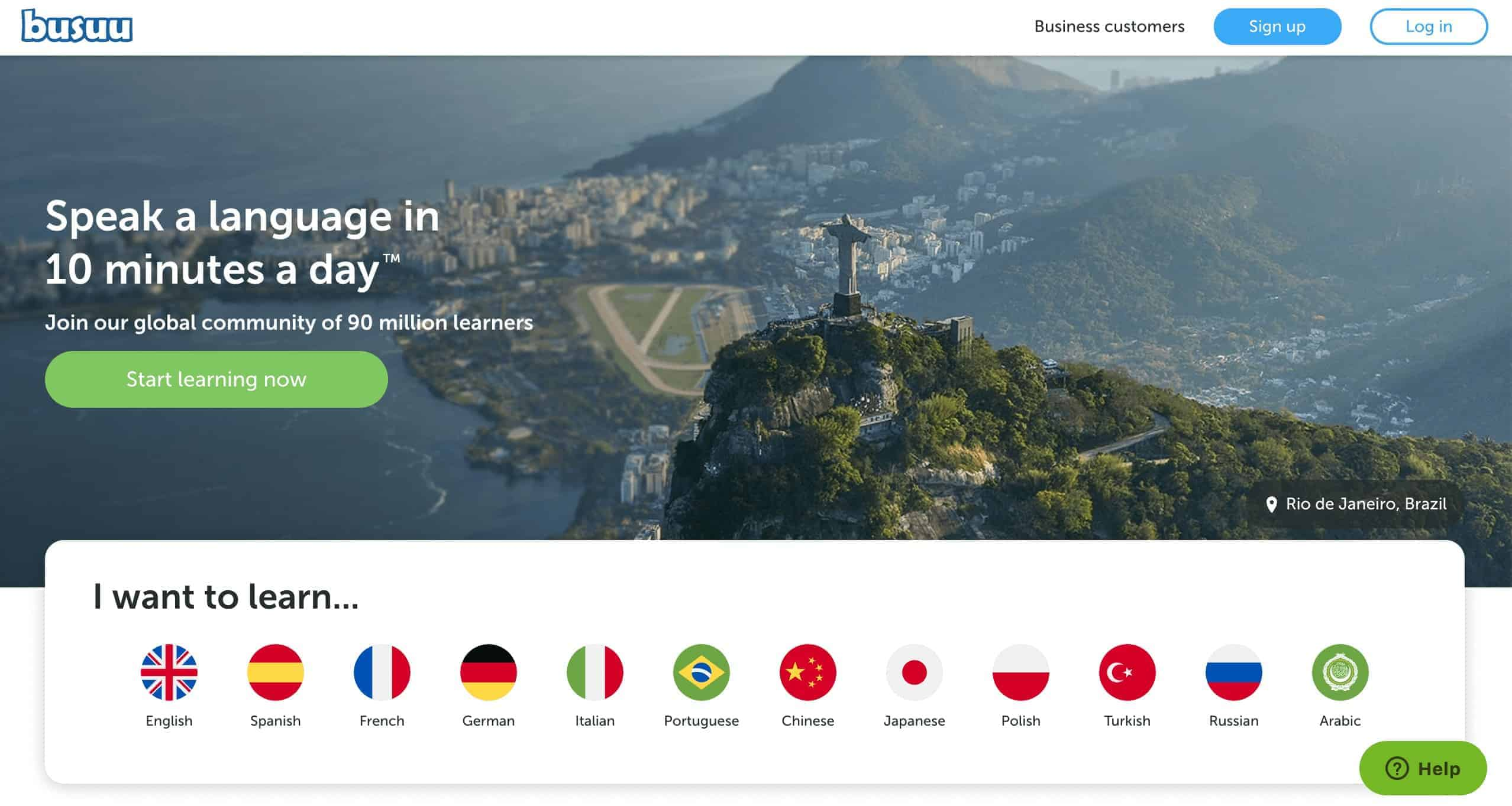 Screenshot of the website Busuu app describing the app against a picture of a scenic view of Rio with an array of flags at the bottom.