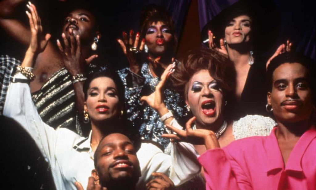 A group of black drag queens, trans women and queer folk in the early 90s posing dramatically