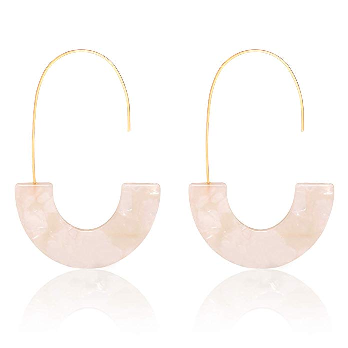Gold colored earrings with a light pink resin half-hoop.