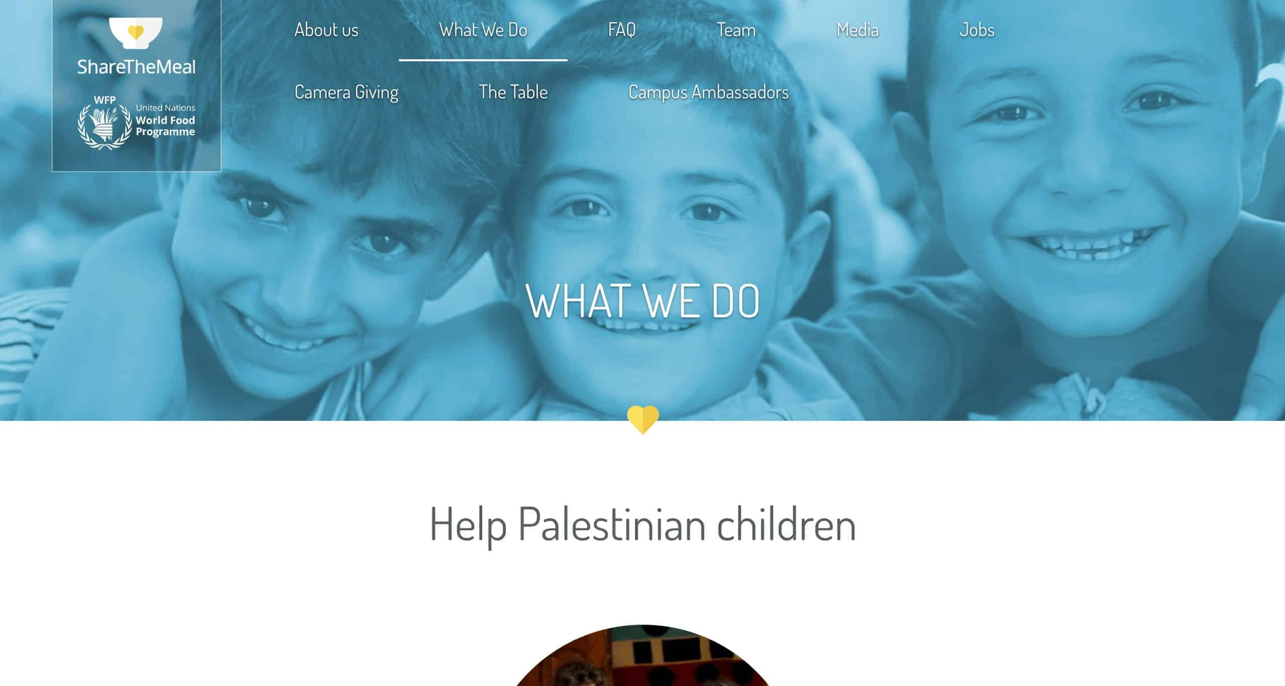 Screenshot of the share the meal website that it light blue on top with the faces of three children smiling and white at the bottom.