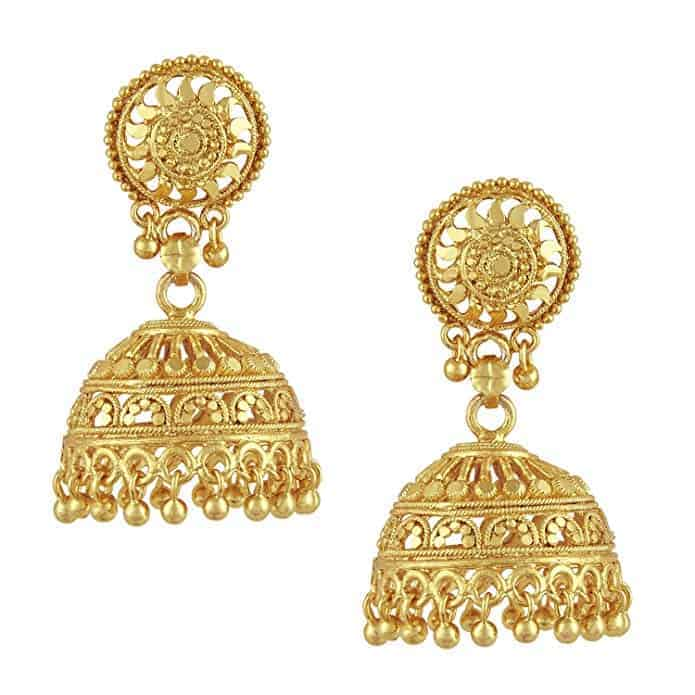 A pair of intricate gold chandelier earrings.