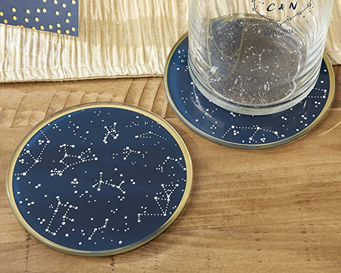 Two gold and navy coasters with constellations printed on them.