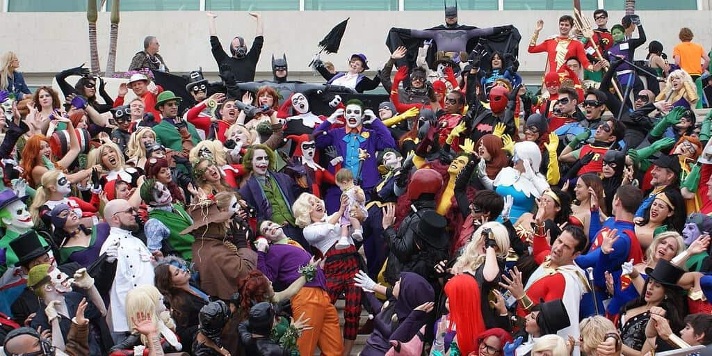 A crowd of people dressed in different superhero and villain costumes. / Via Pat Loika on Wikimedia Commons