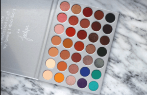 Morphe x Jaclyn Hill eyeshadow palette open with a rainbow of colors in circular pans