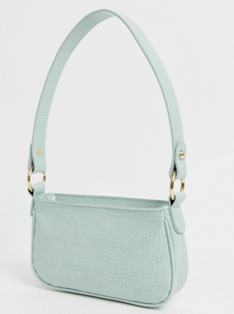 A mint green crocodile-effect shoulder bag with gold accents.