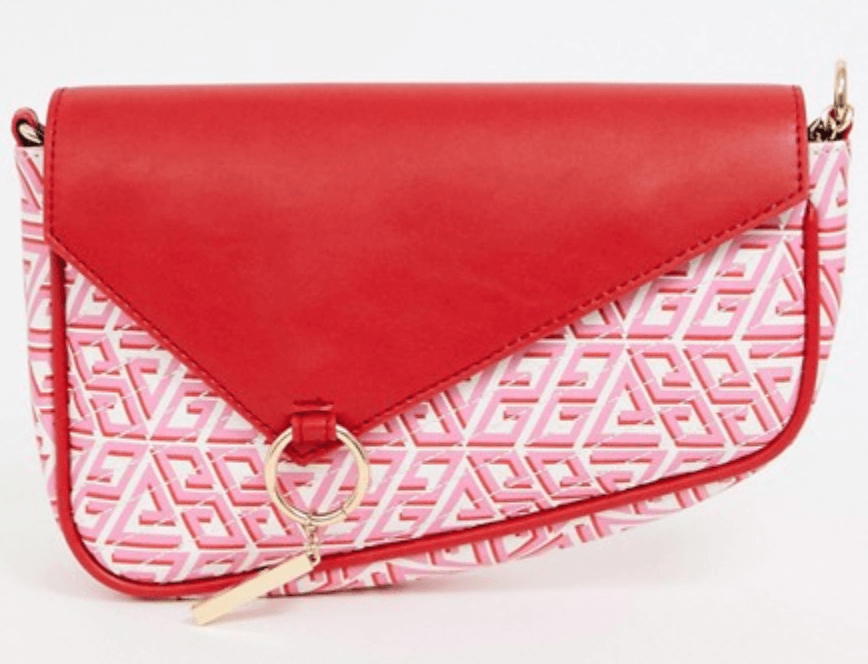 A shoulder bag with a red top and piping, gold detail and a red and pink pattern on the bottom.