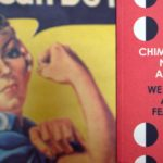 An orange-cover book, titled We Should All Be Feminists, is held in front of an illustration of a woman in a denim shirt and red-knotted headband who has her right bicep curled in show of strength.