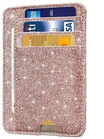 A glittery pink card holder wallet with three cards poking out