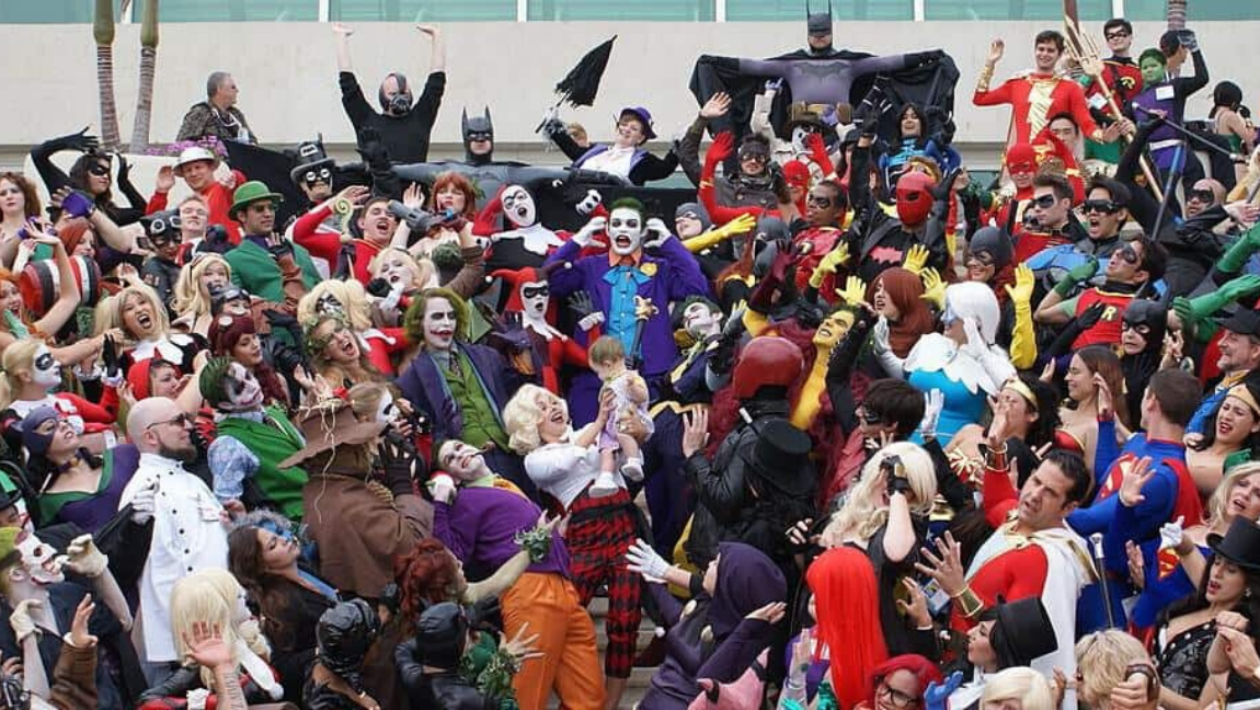 [Image description: A crowd of people dressed in different superhero and villain costumes.] Via Pat Loika on Wikimedia Commons
