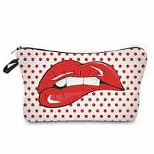 A white pouch with red dots and a picture of teeth biting lower lip