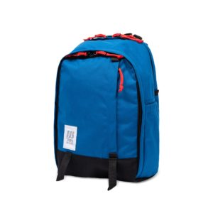 [Image description: Core Pack in blue with red zipper pulls against white background.] Via Topo.