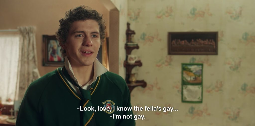 """A brown-haired, white boy responds to someone off-screen, saying: """"I'm not gay."""""""