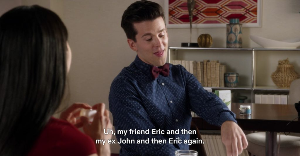 """A brown-haired white man in a blue button-down and red bowtie says: """"Uh, my friend Eric and then my ex John, and then Eric again."""""""