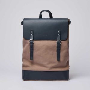 [Image description: Hege backpack in Earth Brown with Navy Leather against grey background.] Via Sandqvist.