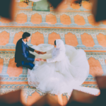 [Image Description: A bird's eye view of a newly married couple, a man in a suit on the left and a woman in a white dress on the right] Photo by Ramiz Dedaković on Unsplash