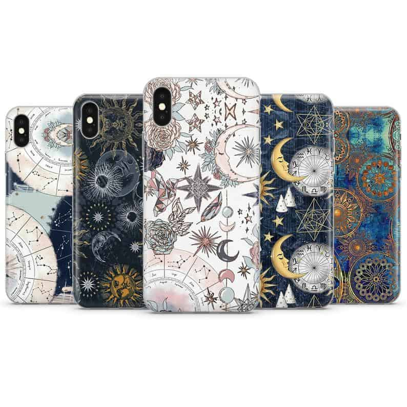 Several phone cases laid atop each other, in a variety of different colors and zodiac patterns.
