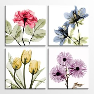 4 floral paintings hanging on a wall.