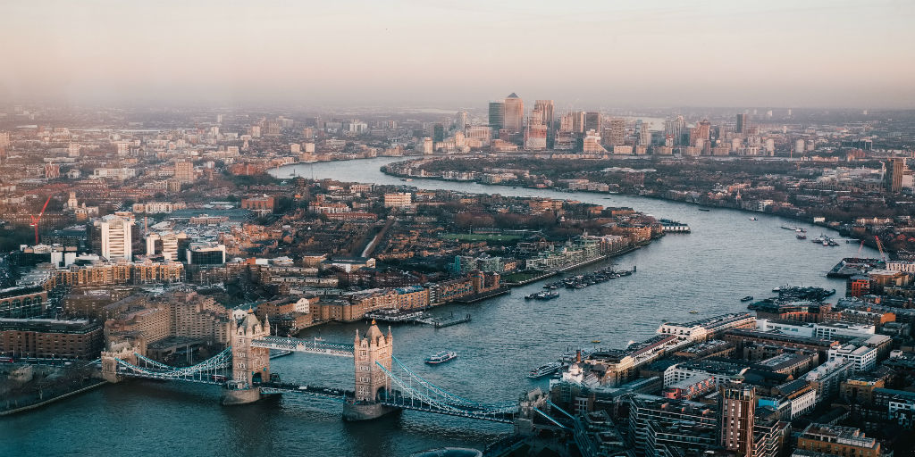 [Image Description: An aerial shot of the River Thames in London, with Tower Bridge in the foreground] via Benjamin Davies, Unsplash