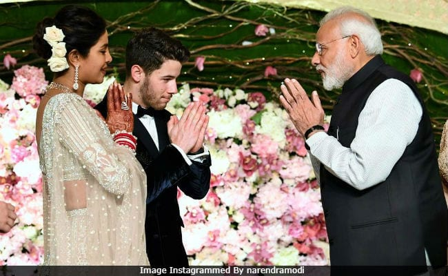 [Image description: Priyanka Chopra and husband Nick Jonas greeting India's PM Narendra Modi] via Instagram
