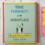 "[Image description: On a marble top lies the book ""Toxic Femininity in the Workplace"" by Ginny Hogan. On its right is a pile of sticky notes and, on its left, four colored pens.] Via Ginny Hogan"