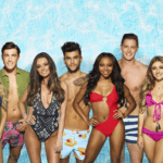 [Image description: The cast of Love Island pose for a publicity image.] Via ITV.