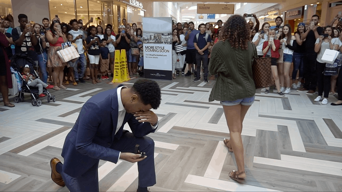 [Image description: Man seems sad after a proposal while a woman walks away.] via Youtube