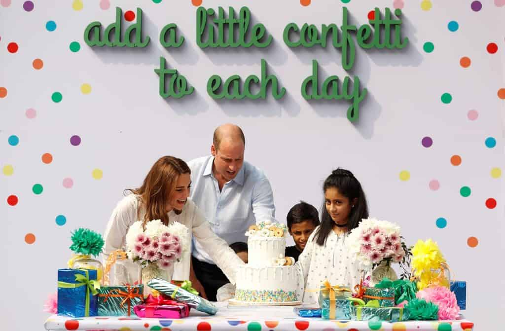 Kate Middleton and Prince William cutting a birthday cake at the SOS children's village in Lahore.