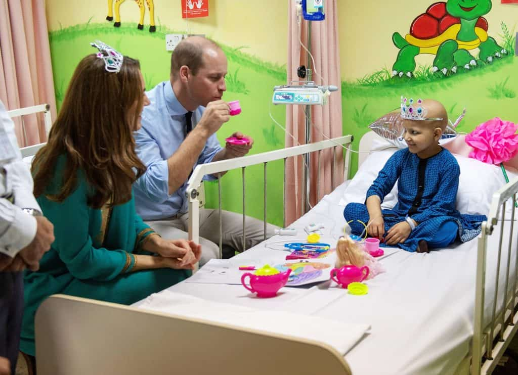 Britain's Prince William and Kate Middleton, Duchess of Cambridge visit a 7-year-old child at the Shaukat Khanum Memorial Cancer Hospital in Lahore, Pakistan