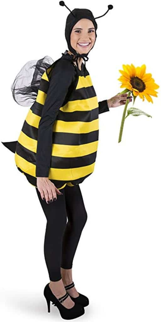 A woman in a black-and-yellow bee costume holding a sunflower.