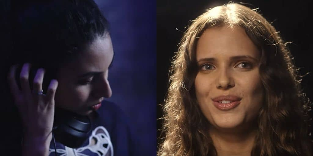 The side profile of a brown-skinned woman, Kyran, with black hair, holding headphones to her ear. On the right, another brown-skinned woman, Maya, with green eyes smiles at the camera in a close-up shot of her face. Her brown hair is illuminated by soft light.