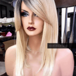 A blonde wig with dark brown roots on a mannequin.