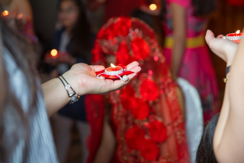 [Image description: Bride is celebrated during henna night.] via Shutterstock